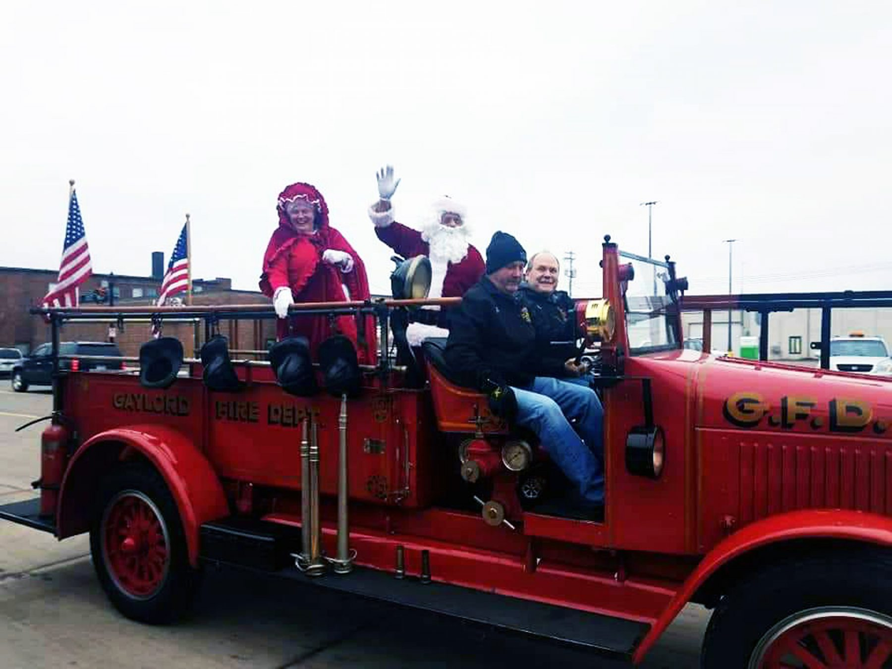 Mr. & Mrs. Claus arrived at the library on an old fashioned fire engine